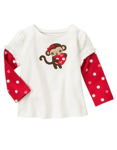 Adorable Valentine style! Our playful tee features a cute monkey with 3-D ears appliquéd in soft faux suede holding an embroidered heart. Finished with heart and dot print inset sleeves for a layered look. 100% cotton rib. Inset sleeve for a layered look. Machine washable. Imported. Collection Name: Valentine's Day.