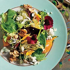 This beautiful walnuts, goat cheese, and greens salad looks like a bouquet on a plate by @CookingLight