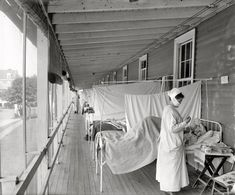 """Washington, D.C., circa 1919. """"Walter Reed Hospital flu ward."""" One of the very few images in Washington-area photo archives documenting the influenza contagion of 1918-1919, which killed over 500,000 Americans and tens of millions around the globe. Most victims succumbed to bacterial pneumonia following influenza virus infection. Harris & Ewing"""