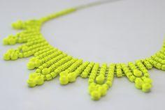 Neon spray paint + an old rhinestone necklace. Fun!