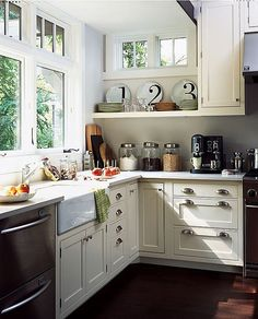 farmhouse kitchen, just love everything about it, the best being the window infront of the sink, and that sink! Gorgeous!
