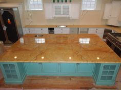 Kitchen Island!  2 full book matched slabs expertly done by Tropical Stone and Apollo Granite & Marble.  Kuntry Craft cabinets.