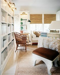 neutrals & layers, rattan chair, white bookshelves with brass library lights