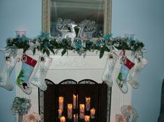 """#FanDesign  """"Instead of using names, I found small picture frames and put their pictures on the stockings instead,"""" says HGTV fan ' lej233.'    Like her mantel? You'll love her Christmas tree>> http://www.roomzaar.com/rate-my-space/Holidays/Blue-Christmas-2011/detail.esi?oid=29729195&soc=pinterest"""
