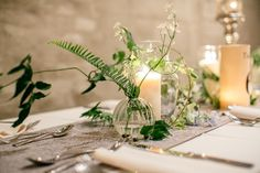 modern centerpieces using ferns - photo by http://emilywrenweddings.com/ - http://ruffledblog.com/front-palmer-philadelphia-wedding/
