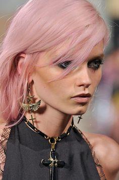 Soft pink hair on darker skin.