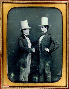 ca. 1850's, [daguerreotype portrait of two gentlemen in white beaver fur hats posed, shaking hands]  via the Daguerreian Society, Mark Koenigsberg Collection