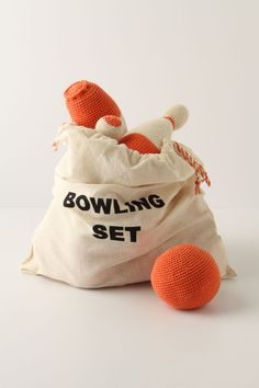 inspiration:  crocheted bowling set...could make a DIY version with yarn-wrapped wooden pins and wooden ball, or even plastic water bottles of a similar shape