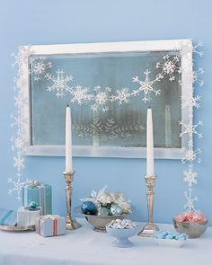 How-to snowflake garland.. Martha says you can do it this way.... But why couldn't you make your own with the plastic snow flakes from walmart or the dollar store that come in a box of 10 or 12