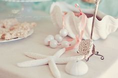 """I love this idea for a mermaid party! """"Pearl"""" necklaces made from white gumballs and ribbons : )"""
