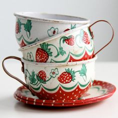 Such a sweetly pretty set of strawberry print Wolverine brand tin tea cups and saucers from the 1950s. #vintage #retro #1950s #teacups #kitchen #toys #tea #party #cute #strawberries