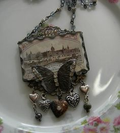 Soldered Glass Assemblage Charm Necklace by Vintagearts on Etsy, $60.00
