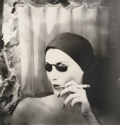 Irving Penn, Woman on the beach smoking (Mary Jane Russell), Long Island, NY, 1949