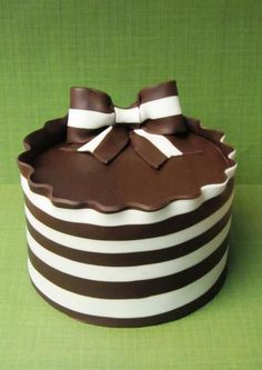 Red velvet cake filled and iced with white chocolate cream cheese buttercream. Covered with homemade, hand striped white and dark modeling chocolate.
