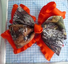 For Lynz? Mossy Oak Camo Hair Bow - Orange Double Ruffle. $3.50, via Etsy.