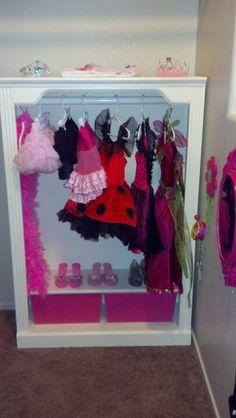 Dress up closet I made out of a shelf.
