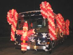 Christmas Float Theme Ideas | BALLOON SANTA AND BALLOON CANDY CANES FOR KISS COUNTRY RV PARADE FLOAT