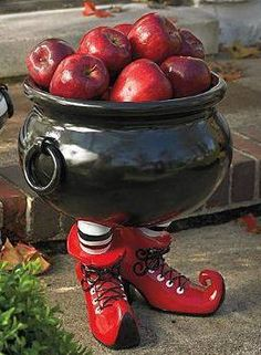 Cauldron with Legs http://eighteen25.blogspot.com/2011/10/todays-guest-design-dazzle.html Make a spooktacularly sweet display of wrapped candy for party guests and trick-or-treaters with the toe-curling and fabulous Cauldron with Legs.
