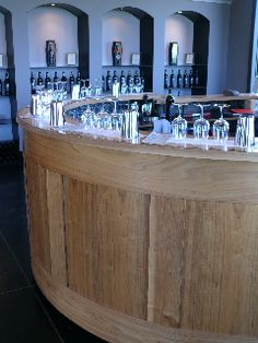 The bar at Coffin Ridge Winery built by one of the areas best cabinet creators Tim Singbeil - full story on this creation at http://ecoinhabit.com/sipping-wine-in-sophistication-at-coffin-ridge-boutique-winery/