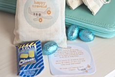Personal note + candy + cute packaging = Happy Travels gifts for passengers on long plane rides...so they'll more easily ignore your crying/whining/hyper kiddos!  :) kid
