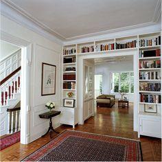 love the bookshelves surrounding the wide doorway