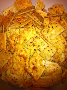 Spicy Hot Crackers....    1 1/4 cup canola oil, 1 pkg ranch dressing mix, 2 tbsp. red pepper flakes, 1 (16oz) box saltine crackers. Directions: Mix oil, ranch mix, red pepper flakes in a bowl. Allow to sit for 5 minutes to allow the oils to absorb all the seasonings. Place the crackers in a large zip lock bag and pour the oil over the crackers. Tumble constantly for 15 minutes. Enjoy!