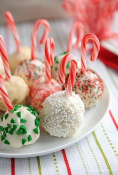 Christmas Ornament Cake Balls; uses mini candy canes for ornament hooks