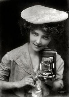 1900's Camera girl.