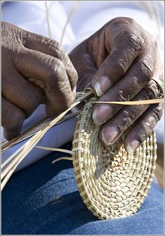 Sweet, Sweet Sweetgrass Baskets    Visitors to Charleston stop to admire the skills of sweetgrass basket makers along the streets of the city.