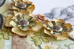 Click on the photo to take you to a torn cardstock flower tutorial I shared at my blog :)