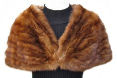 Vintage Golden Sable Shrug; #SS484; SOLD!; Very Good Condition; Size range: S - M. This is a gorgeous vintage genuine golden sable fur shrug. It has a John W. Taylor label. The lining is dark olive green silk and there is NO MONOGRAM. It has one hook and eye closure. This luxurious sable shrug will take you to even the most formal events and you will look and feel fabulous!