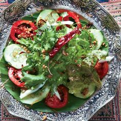 This refreshing salad is made with an array of delicious ingredients—greens, shallot, hard-cooked egg, salted peanuts, tomatoes and cucumber.