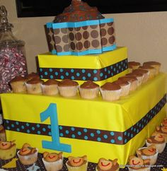 Cupcake tower made out of cardboard boxes and wrapping paper