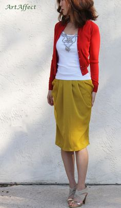 Cool color combo. Mustard yellow skirt, white embellished top, and red cardigan.