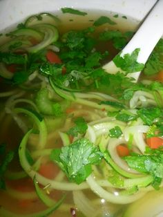 Zucchini Noodle Soup - #Vegan #Recipe - veggie broth - 3 cups of water - 1 stalk of celery, chopped - 1/2 red pepper, diced - 1 zucchini, chop the two ends off and leave whole - pepper and red chili flakes to taste - handful of parsley, as garnish