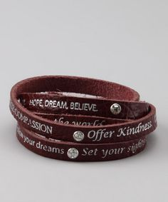 Don't be fooled by the rock star look—this handmade leather bracelet is as sweet as can be! Embossed with encouraging sentiments and featuring genuine Swarovski stones, it's a stylish way to spread a little joy with every twist of the wrist.