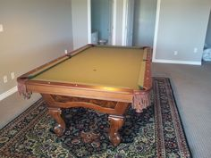 Brunswick Danbury pool table in chestnut finish.  The customer recently had us dismantle the table to have the carpet installed
