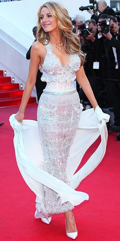 On the Red Carpet at Cannes | BLAKE LIVELY | In case her previous appearance at Cannes didn't leave you totally slack-jawed, Blake hits the carpet in a second stunner (this one, a lace iridescent Chanel Couture creation) and flower-shaped Lorraine Schwartz earrings while having another great hair day at the Mr. Turner premiere.