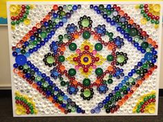 My class made this mandala-inspired art!  We're auctioning it off to raise money for our school.