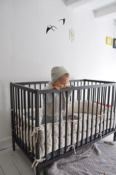 Gray baby bed good idea. much different from the black white brown i always see