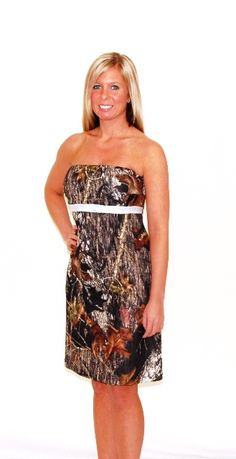 Zoey Dress $129.99 - The cutest, most versatile dress around. This little camo dress looks great with boots or with heels. Wear as a camo party dress, camo bridesmaid dress or camouflage prom dress. Dress it up, dress it down, wear it everyday. Strapless top with feminine cut. Pink piping just below the bust is a fun detail. The fabric is in Mossy Oak New Break Up and has a little shine to it as well as strech for comfort and fit. Licensed Mossy Oak product. Made in USA.