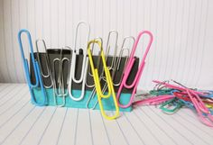 Magnetic paper clip holder made from old ink cartridge.
