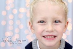 Wrap a tri-fold board with white Christmas lights to use as a background for portraits, creates a soft, non-distracting background.