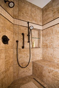 The walk-in shower is accessible design at its best, with bench seating