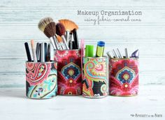 Use fabric covered tin cans to organize makeup and brushes.