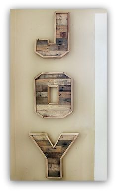 Make letters from pallet wood and spell out simple words for the wall.  So many easy decorating ideas on this website!