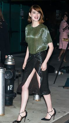 Emma Stone leggy in a green glittery gown for the Manhattan premiere of her film Birdman at Alice Tully Hall