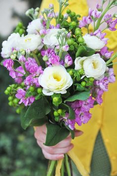 Like this combination with more fuschia.  Ranunculus, St. John's Wort and whatever that long thing is?