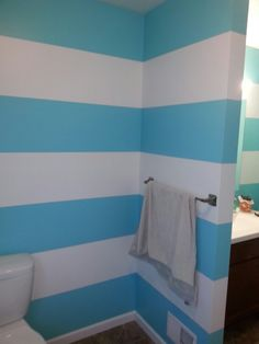 Sherwin Williams Belize blue and white striped bathroom walls.