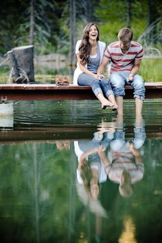 engagement picture. Cute idea to do the photo shoot at a lake dock!